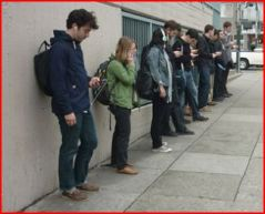 Tech workers await bus in S.F. (source)